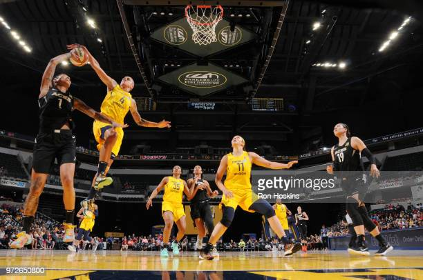 Forward Candice Dupree of the Indiana Fever blocks Forward Tamera Young of the Las Vegas Aces during the game on June 12 2018 at Bankers Life...