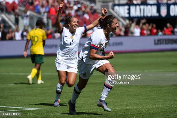 USA forward Carli Lloyd and teammate Mallory Pugh celebrate after Lloyd scored her side's third goal during the friendly match between the United...