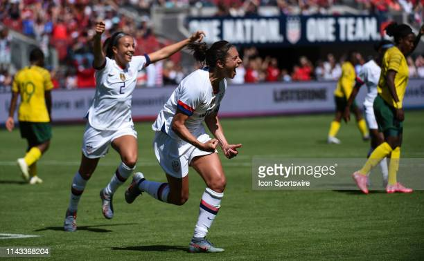 USA forward Carli Lloyd celebrates after scoring her side's third goal during the friendly match between the United States Women's National Team and...