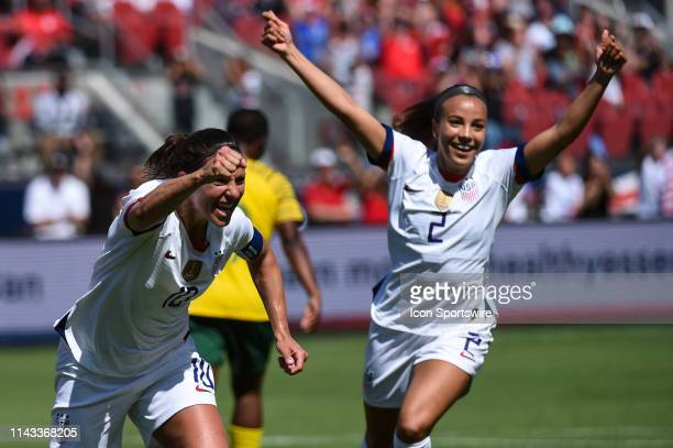 USA forward Carli Lloyd celebrates after scoring her side's third goal alongside teammate Mallory Pugh during the friendly match between the United...