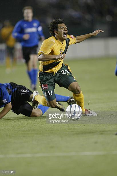 Forward Carlos Ruiz of the Los Angeles Galaxy is fouled by defender Craig Waibel of the San Jose Earthquakes during the Major League Soccer game at...