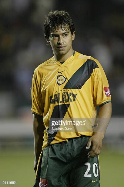 Forward Carlos Ruiz of the Los Angeles Galaxy walks off the field after the Major League Soccer game at the Home Depot Center on June 18 2003 in...