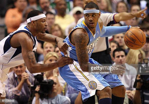 Forward Carmelo Anthony of the Denver Nuggets dribbles the ball against Antoine Wright of the Dallas Mavericks in Game Four of the Western Conference...