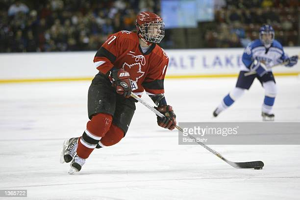 Forward Casssie Campbell of Canada skates with the puck against Finland during their game at the Salt Lake City Winter Olympic Games on February 19...