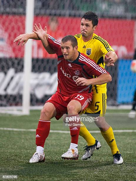Forward Chad Barrett of Toronto FC backs into defender Danny O'Rourke of the Columbus Crew during their match on September 13 2008 at BMO Field in...