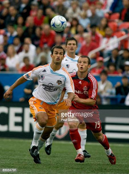 Forward Chad Barrett of Toronto FC fights for the ball with defender Patrick Ianni of the Houston Dynamo during their match on September 27, 2008 at...