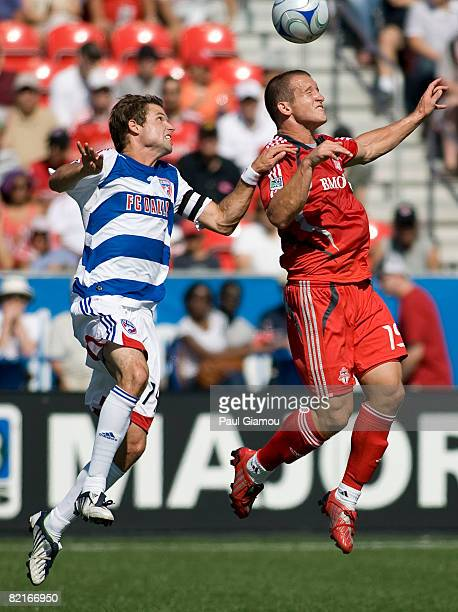Forward Chad Barrett of Toronto FC leaps for the ball with defender Drew Moor of FC Dallas during the match on August 3 2008 at BMO Field in Toronto...