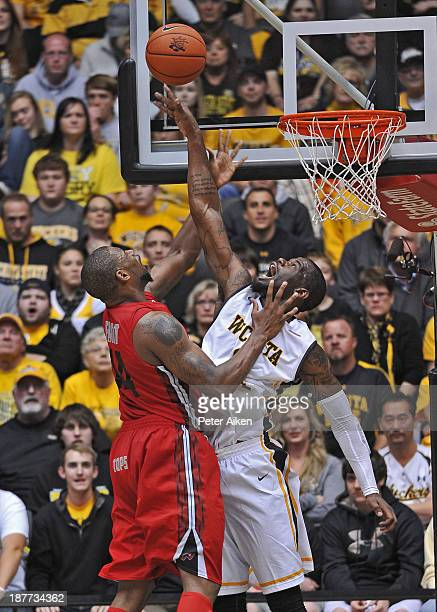 Forward Chadrack Lufile of the Wichita State Shockers blocks the shot of forward George Fant of the Western Kentucky Hilltoppers during the first...