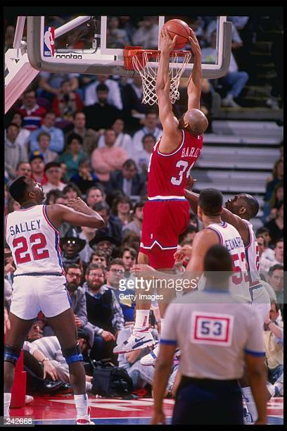 Forward Charles Barkley of the Philadelphia 76ers slam dunks during a game against the Detroit Pistons at The Palace of Auburn Hills in Auburn Hill...