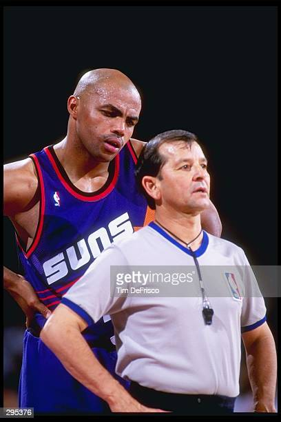 Forward Charles Barkley of the Phoenix Suns confers with an official during a game against the Denver Nuggets at McNichols Arena in Denver Colorado...