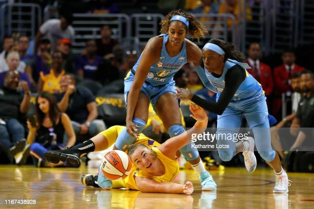 Forward Cheyenne Parker of the Chicago Sky steps over center Maria Vadeeva of the Los Angeles Sparks as guard Kahleah Copper of the Chicago Sky...