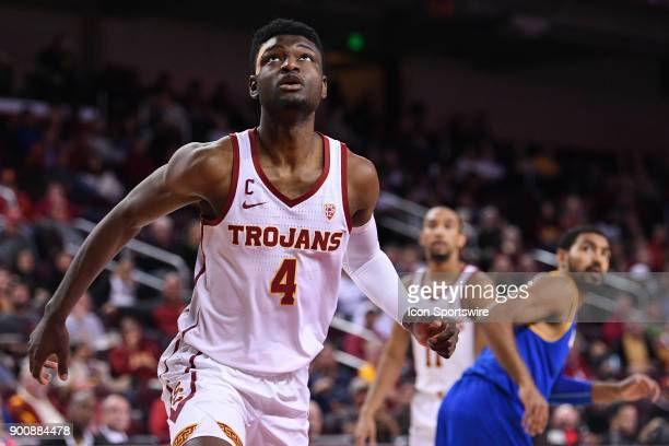 USC forward Chimezie Metu looks to grab a rebound during a college basketball game between the UC Santa Barbara Gauchos and the USC Trojans on...