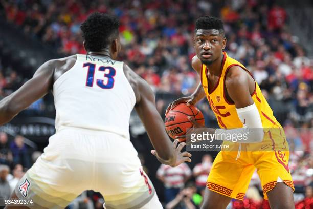 USC forward Chimezie Metu looks to make a pass guarded by Arizona forward Deandre Ayton during the championship game of the mens Pac12 Tournament...