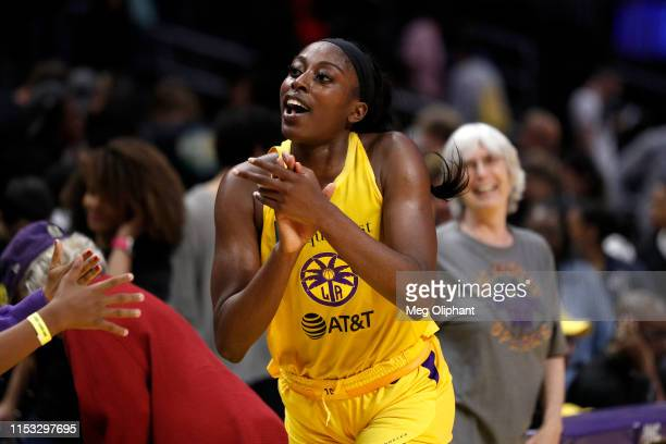 Forward Chiney Ogwumike of the Los Angeles Sparks celebrates after defeating the Connecticut Sun at Staples Center on May 31 2019 in Los Angeles...