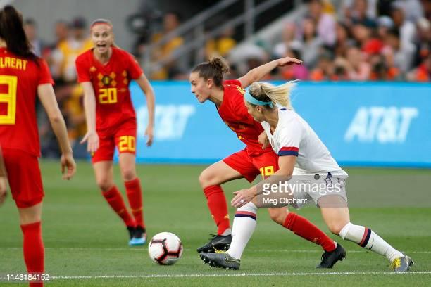 Forward Chloé Vande Velde of the Belgium Women's National Team and midfielder Julie Ertz of the United States Women's National Team go for the ball...