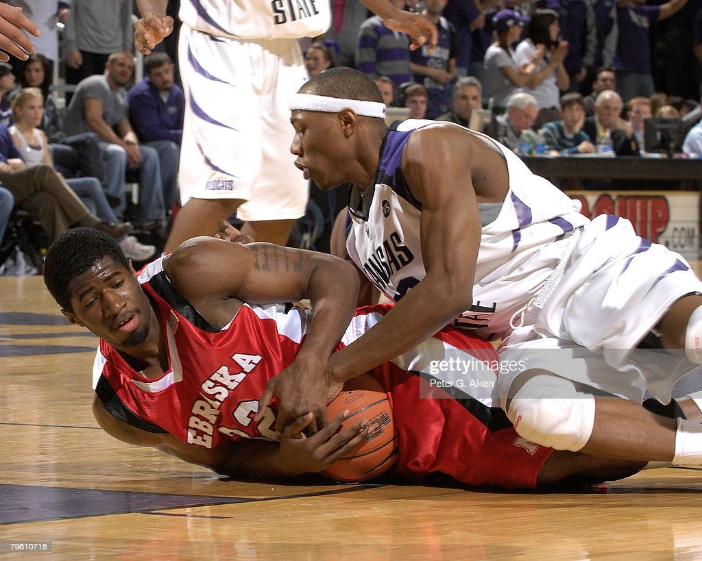 Forward Chris Balham #32 of the Nebraska Cornhuskers battles for a loose ball with Dominique Sutton #23 of the Kansas State Wildcats in the first half of an NCAA Basketball game on February 6, 2008 at Bramlage Coliseum in Manhattan, Kansas.