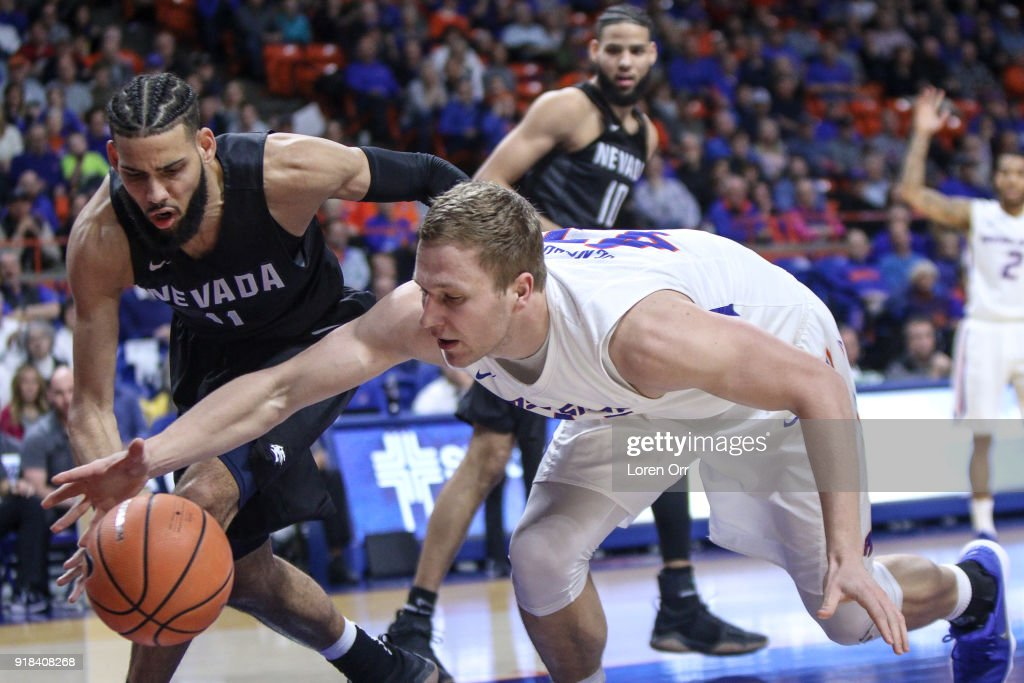 Forward Chris Sengfelder #43 of the Boise State Broncos and forward Cody Martin #11 of the Nevada Wolf Pack go after a loose ball during first-half action on February 14, 2018 at Taco Bell Arena in Boise, Idaho.