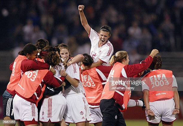 Forward Christine Sinclair of Canada celebrates after defeating China in the quarterfinals of the 2003 FIFA Women's World Cup match at PGE Park on...