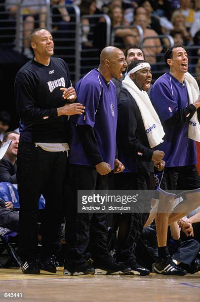 Forward Chucky Brown of the Sacramento Kings cheers with Lawrence Funderburke , Mateen Cleaves and Doug Christie on the sideline in game 3 of the...