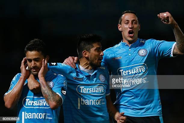 Forward Claudio Bieler of Argentina's Belgrano celebrates with his teammates midfielder Jorge Velazquez and defender Cristian Lema after scoring a...