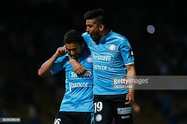 Forward Claudio Bieler of Argentina's Belgrano celebrates with his teammate midfielder Jorge Velazquez after scoring a goal during their Copa...