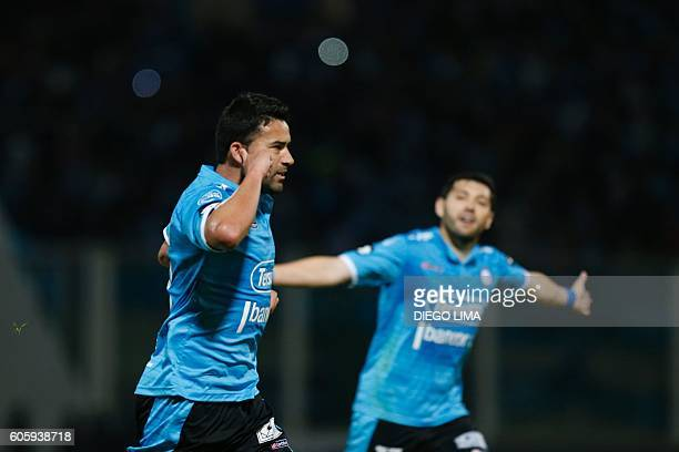 Forward Claudio Bieler of Argentina's Belgrano celebrates with his teammate defender Jose Rojas after scoring a goal during their Copa Sudamericana...