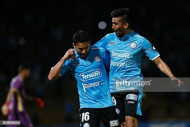 Forward Claudio Bieler of Argentina's Belgrano celebrates with midfielder Jorge Velazquez after scoring his first goal during their Copa Sudamericana...