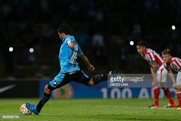 Forward Claudio Bieler of Argentina's Belgrano shoots a penalty to score his first goal during their Copa Sudamericana football match against...