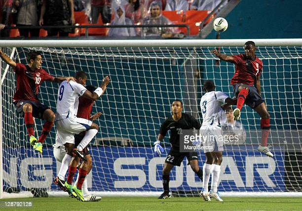 Forward Clint Dempsey and Maurice Edu of the USA shoot against Honduras at Sun Life Stadium on October 8 2011 in Miami Gardens Florida