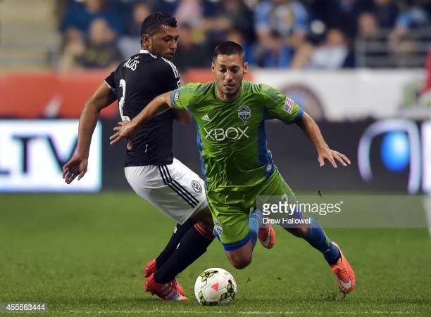 Forward Clint Dempsey of the Seattle Sounders FC trips over defender Carlos Valdes of the Philadelphia Union during the 2014 US Open Cup Final at PPL...