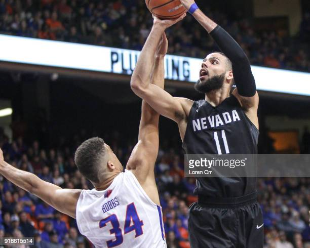 Forward Cody Martin of the Nevada Wolf Pack shoots for two points over the defense of guard Alex Hobbs of the Boise State Broncos during second half...