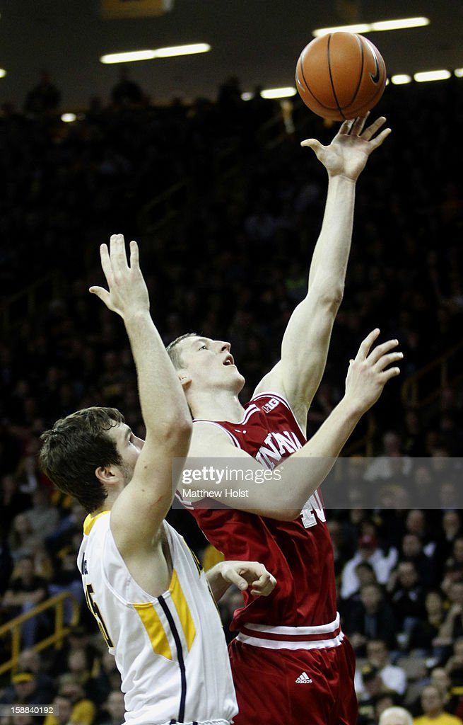 Forward Cody Zeller #40 of the Indiana Hoosiers goes to the basket during the second half against center Adam Woodbury #34 of theIowa Hawkeyes on December 31, 2012 at Carver-Hawkeye Arena in Iowa City, Iowa. Indiana won 69-65.
