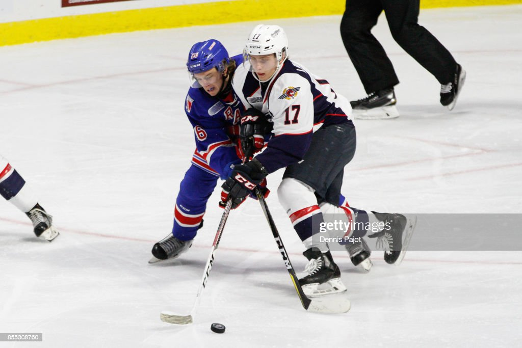 Forward Cole Carter #26 of the Kitchener Rangers battles for the puck against forward Igor Larionov #17 of the Windsor Spitfires on September 28, 2017 at the WFCU Centre in Windsor, Ontario, Canada.