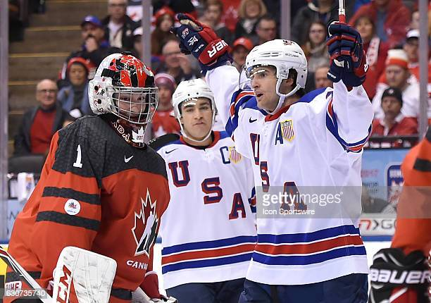 USA forward Colin White reacts after scoring on Canada goalie Connor Ingram in the first period at the World Junior Hockey Championships on December...