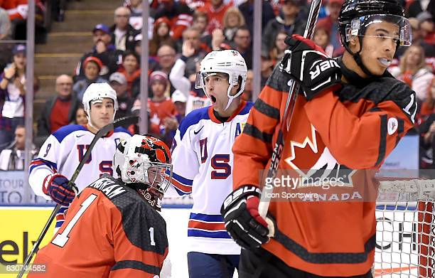 USA forward Colin White readcts after scoring against Canada goalie Connor Ingram in the first period during the World Junior Hockey Championships on...