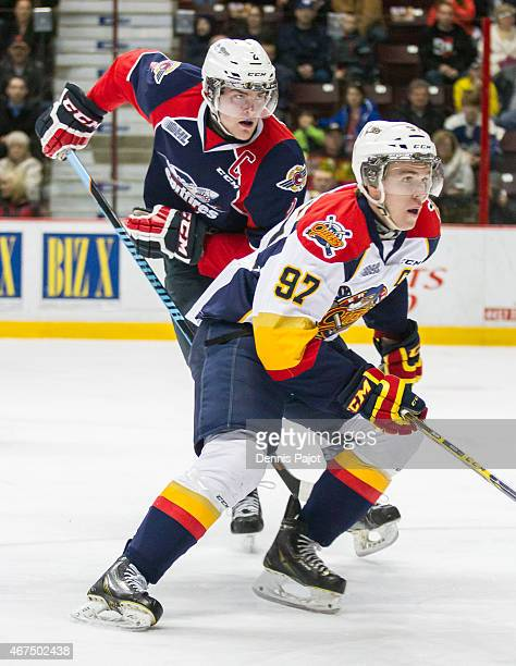 Forward Connor McDavid of the Erie Otters battles against defenceman Patrick Sanvido of the Windsor Spitfires on March 19 2015 at the WFCU Centre in...