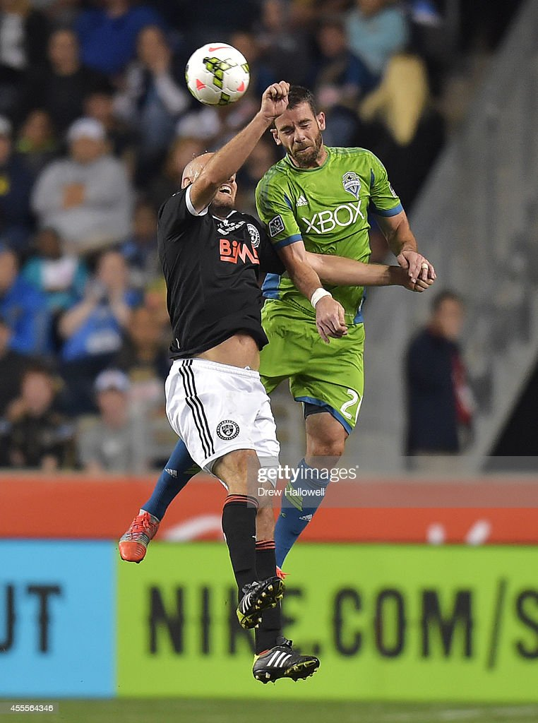 Forward Conor Casey #6 of the Philadelphia Union and defender Zach Scott #20 of the Seattle Sounders FC head the ball during the 2014 U.S. Open Cup Final at PPL Park on September 16, 2014 in Chester, Pennsylvania. The Sounders won 3-1.