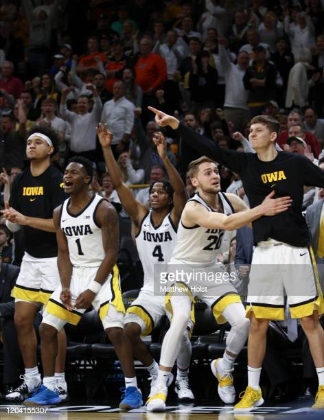 Forward Cordell Pemsl guard Joe Toussaint guard Bakari Evelyn forward Riley Till and guard Austin Ash of the Iowa Hawkeyes celebrate a basket from...
