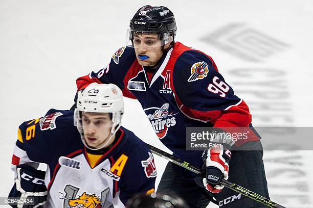 Forward Cristiano DiGiacinto of the Windsor Spitfires battles against forward Andrew Mangiapane of the Barrie Colts on February 25, 2016 at the WFCU...
