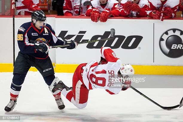 Forward Cristiano DiGiacinto of the Windsor Spitfires places a hit against forward Blake Speers of the Sault Ste Marie Greyhounds on February 18 2016...