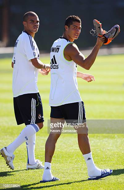 Forward Cristiano Ronaldo and defender Pepe of Real Madrid arrive for a training session on the campus of UCLA on August 3 2010 in Los Angeles...