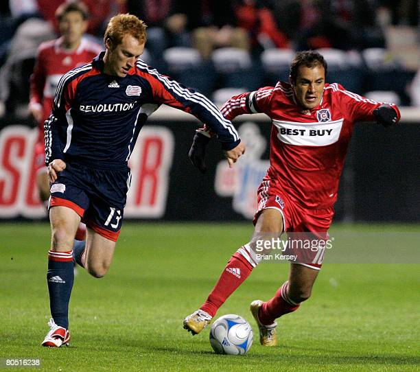 Forward Cuauhtemoc Blanco of the Chicago Fire moves the ball up the field as midfielder Steve Larentowicz of the New England Revolution defends...
