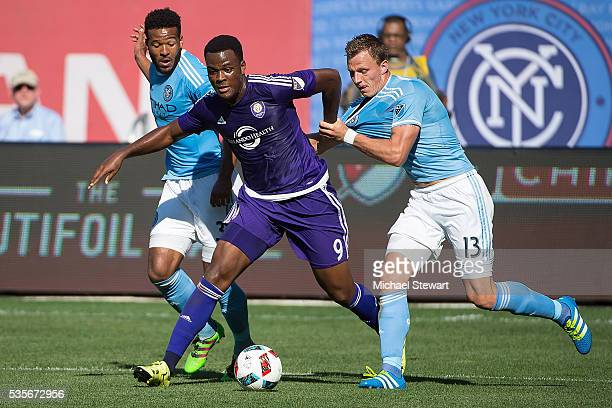 Forward Cyle Larin of Orlando City FC and Frederic Brillant of New York City FC vie for the ball during the match at Yankee Stadium on May 29 2016 in...