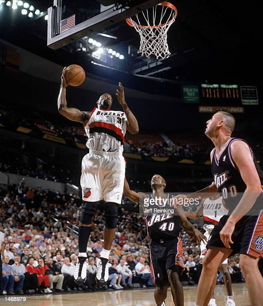 Forward Dale Davis of the Utah Jazz grabs a rebound during the preseason NBA game against the Portland Trail Blazers on October 8 2002 at the Rose...