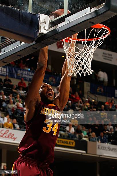 Forward Damian Johnson of the Minnesota Golden Gophers dunks the ball against the Michigan State Spartans during the quarterfinals of the Big Ten...
