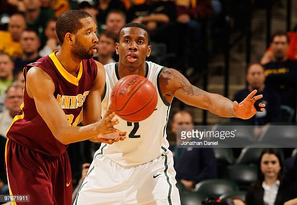 Forward Damian Johnson of the Minnesota Golden Gophers passes the ball as Raymar Morgan of the Michigan State Spartans defends during the...
