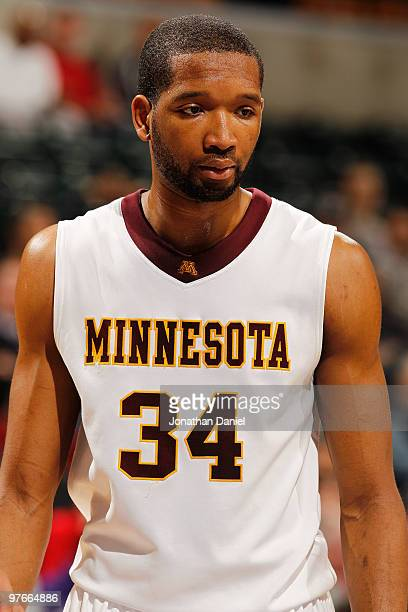 Forward Damian Johnson of the Minnesota Golden Gophers stands on the court during the game against the Penn State Nittany Lion in the first round of...