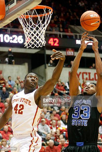 Forward Daniel Edozie of the Iowa State Cyclones battles for a rebound with forward Markus Crider of the Georgia State Panthers in the second half on...