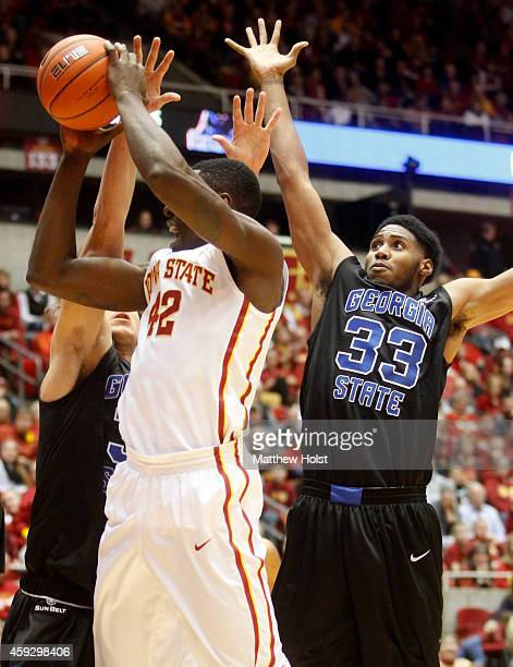 Forward Daniel Edozie of the Iowa State Cyclones drives to the basket in front of forward Markus Crider of the Georgia State Panthers in the first...