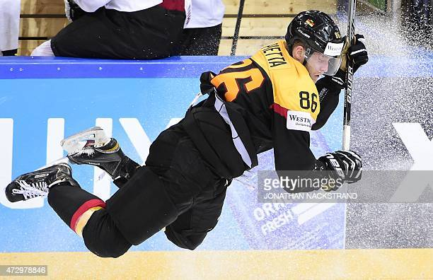 CROP Forward Daniel Pietta of Germany jumps to avoid a tackle by forward Raphael Herburger of Austria during the group A preliminary round match...